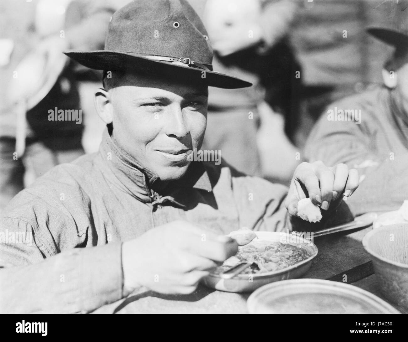 U.S. Army soldier eating during World War II. - Stock Image