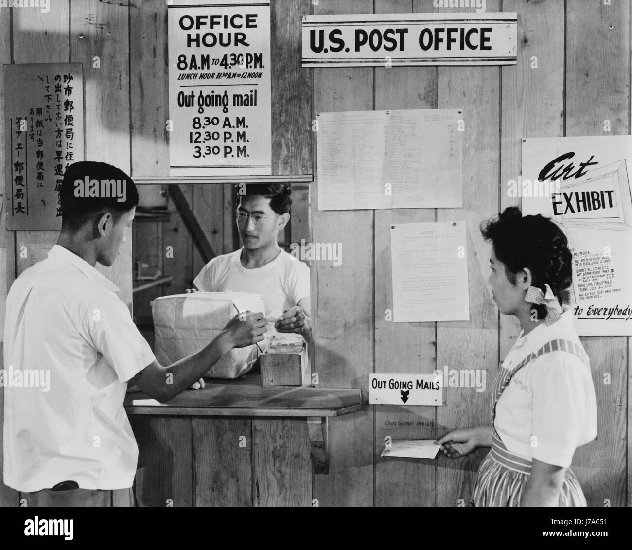 Japanese Americans using postal service, 1942. - Stock Image