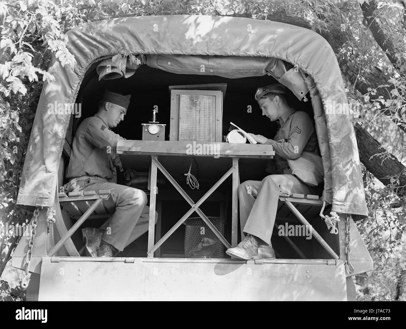 Signal Corps message center set up during a field problem at Fort Riley, Kansas, 1942. - Stock Image