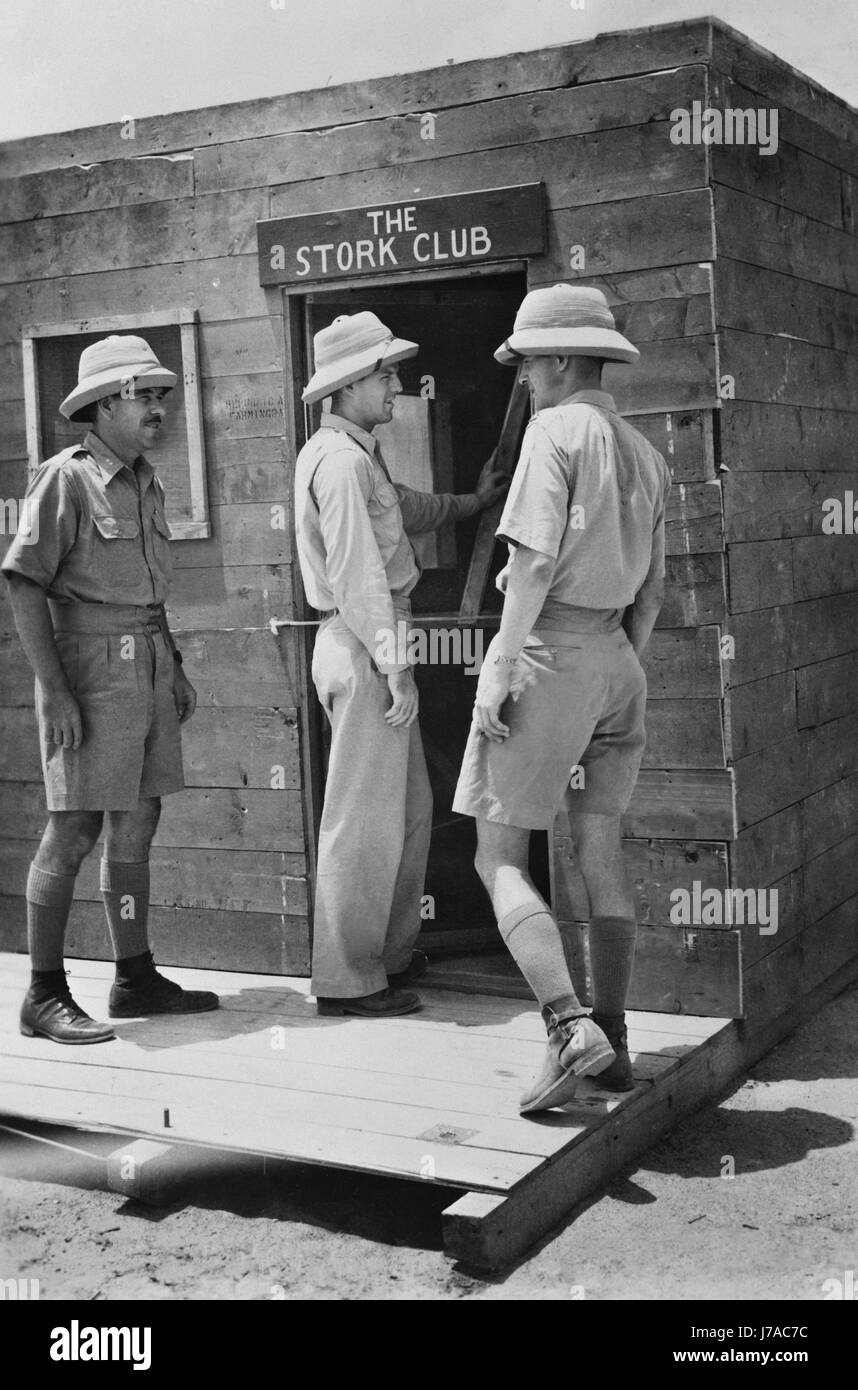 Officers entering their mess, which is constructed of used airplane crates, India. circa 1942 - Stock Image