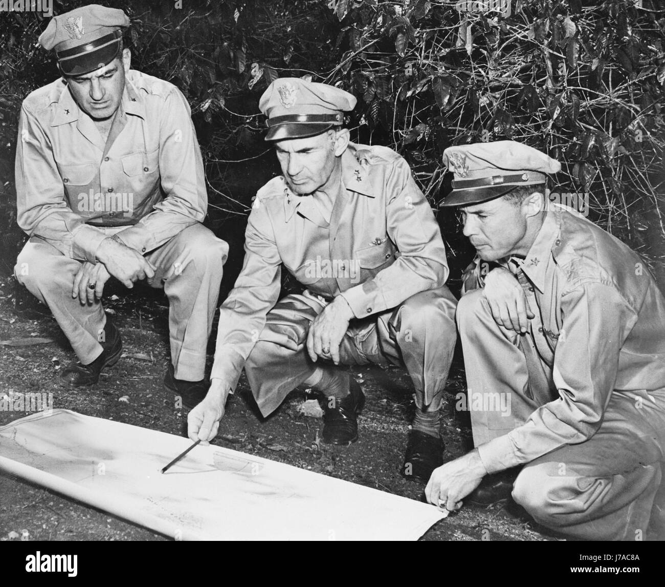 U.S. Army members reviewing a map in the South Pacific area, circa 1942. - Stock Image