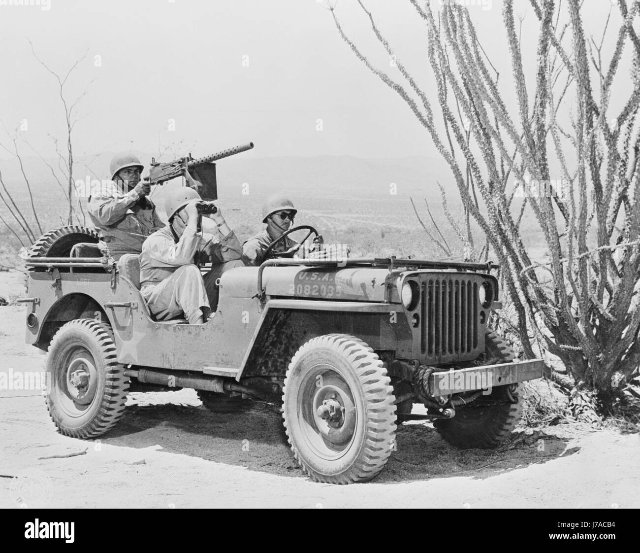 U.S. soldiers on a reconnaissance patrol in their jeep, 1942. - Stock Image
