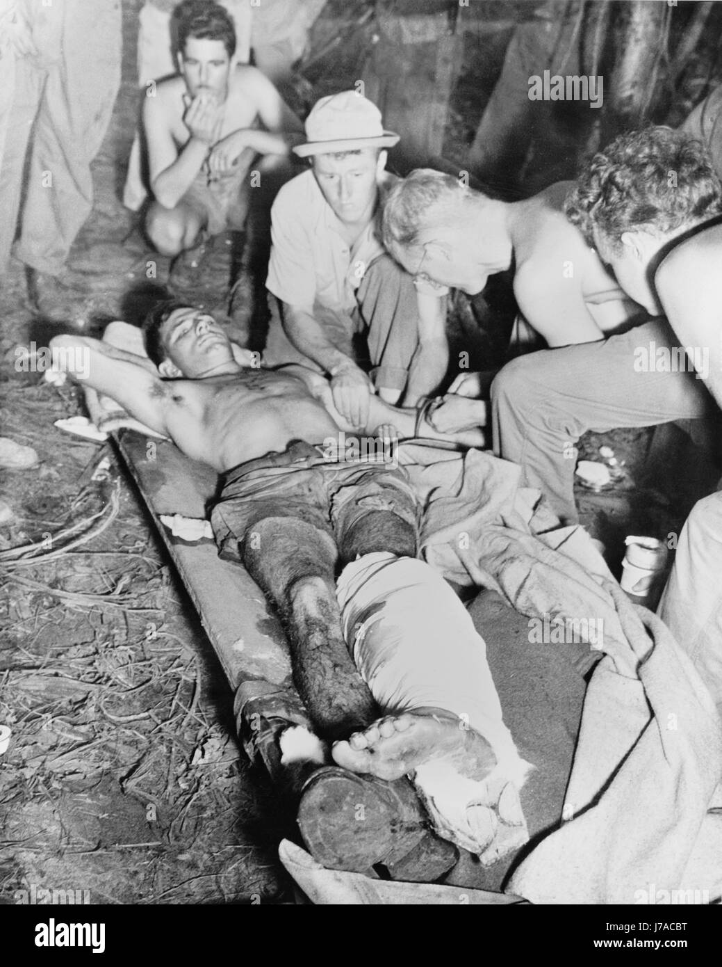A wounded American soldier gets a blood transfusion, New Guinea, circa 1942-1945. - Stock Image