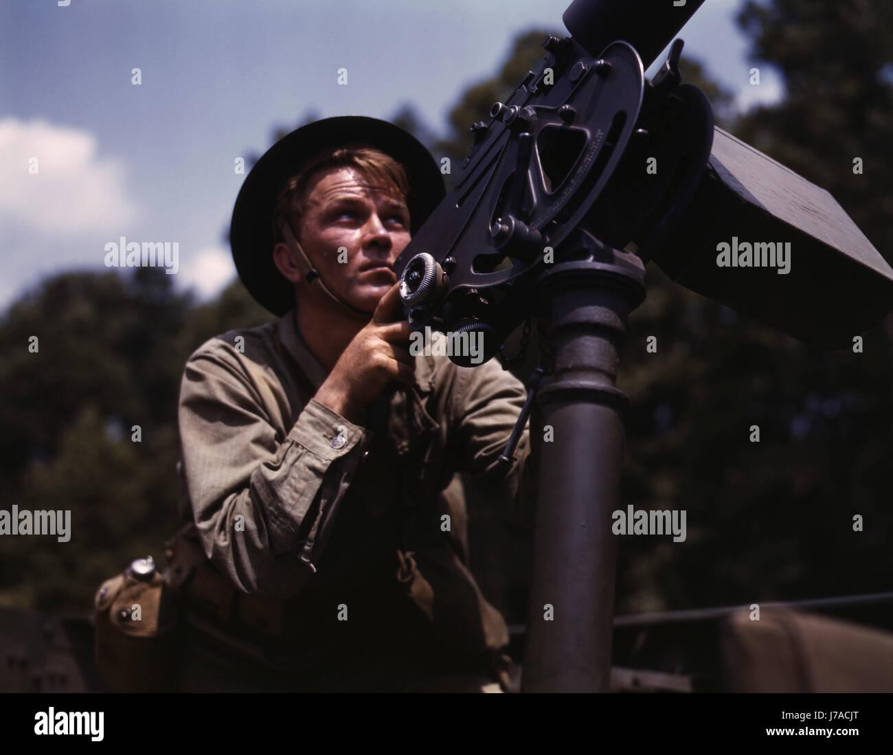 A U.S. soldier shooting a 30 caliber Browning machine gun. - Stock Image