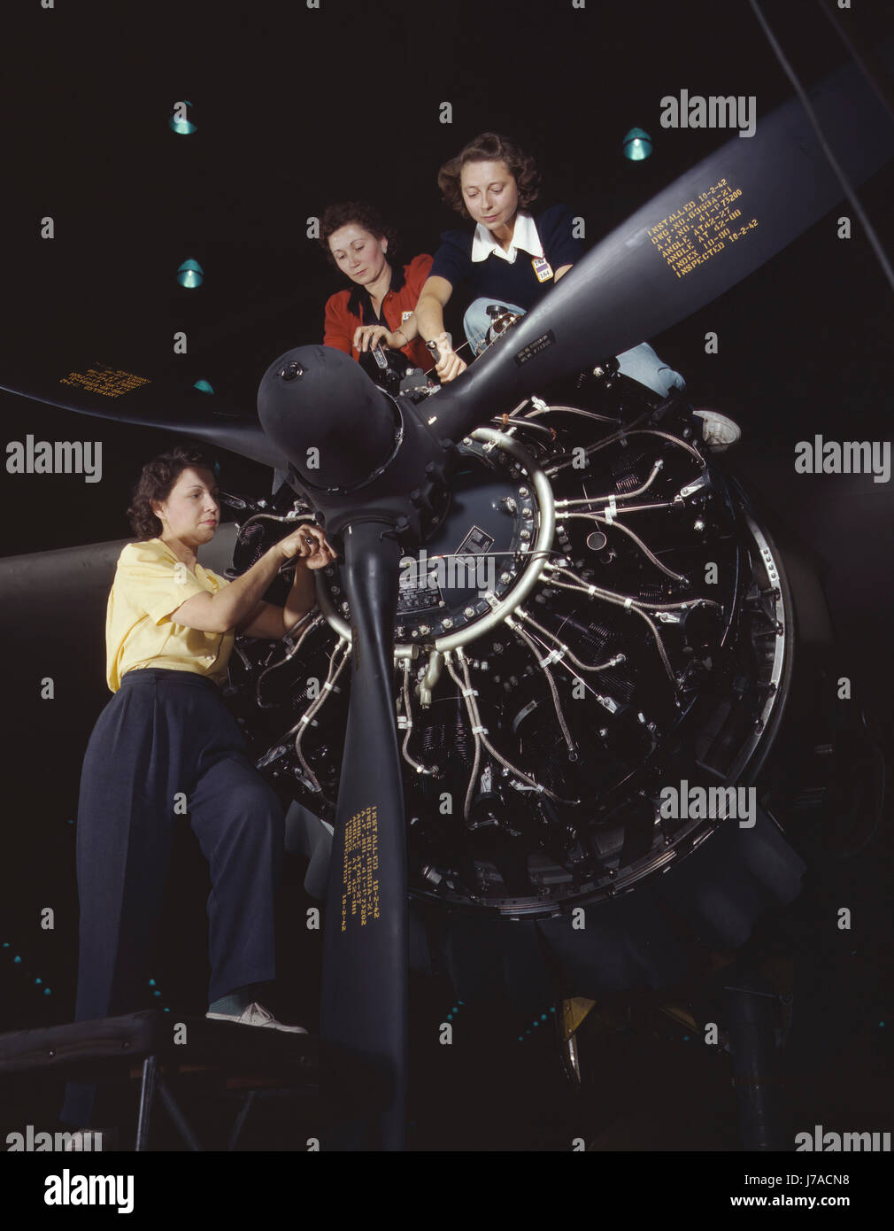 Women working on a C-47 cargo transport plane at an aircraft assembly plant, 1942. - Stock Image