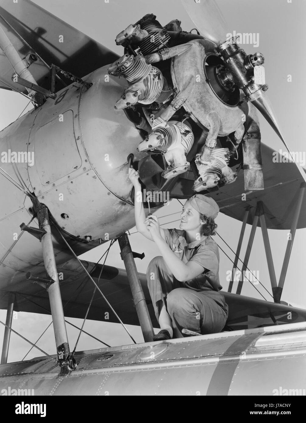 A top-notch mechanic expertly rebuilds airplane engines, 19442. - Stock Image