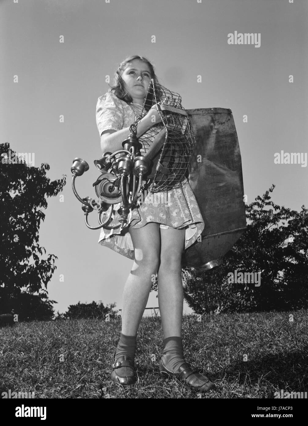A young girl collects scrap for America's war industries, 1942. - Stock Image