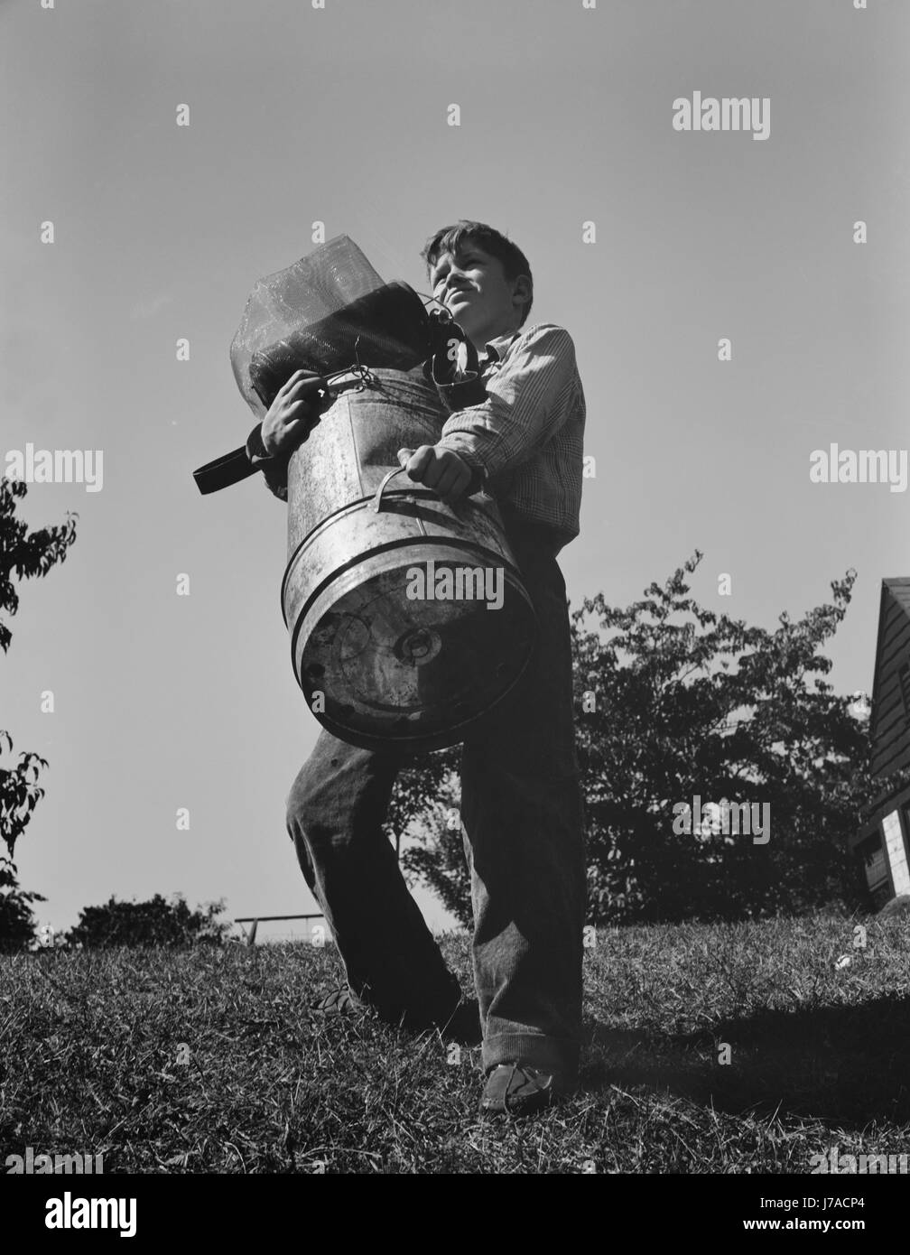 A young boy collects scrap for America's war industries, 1942. Stock Photo