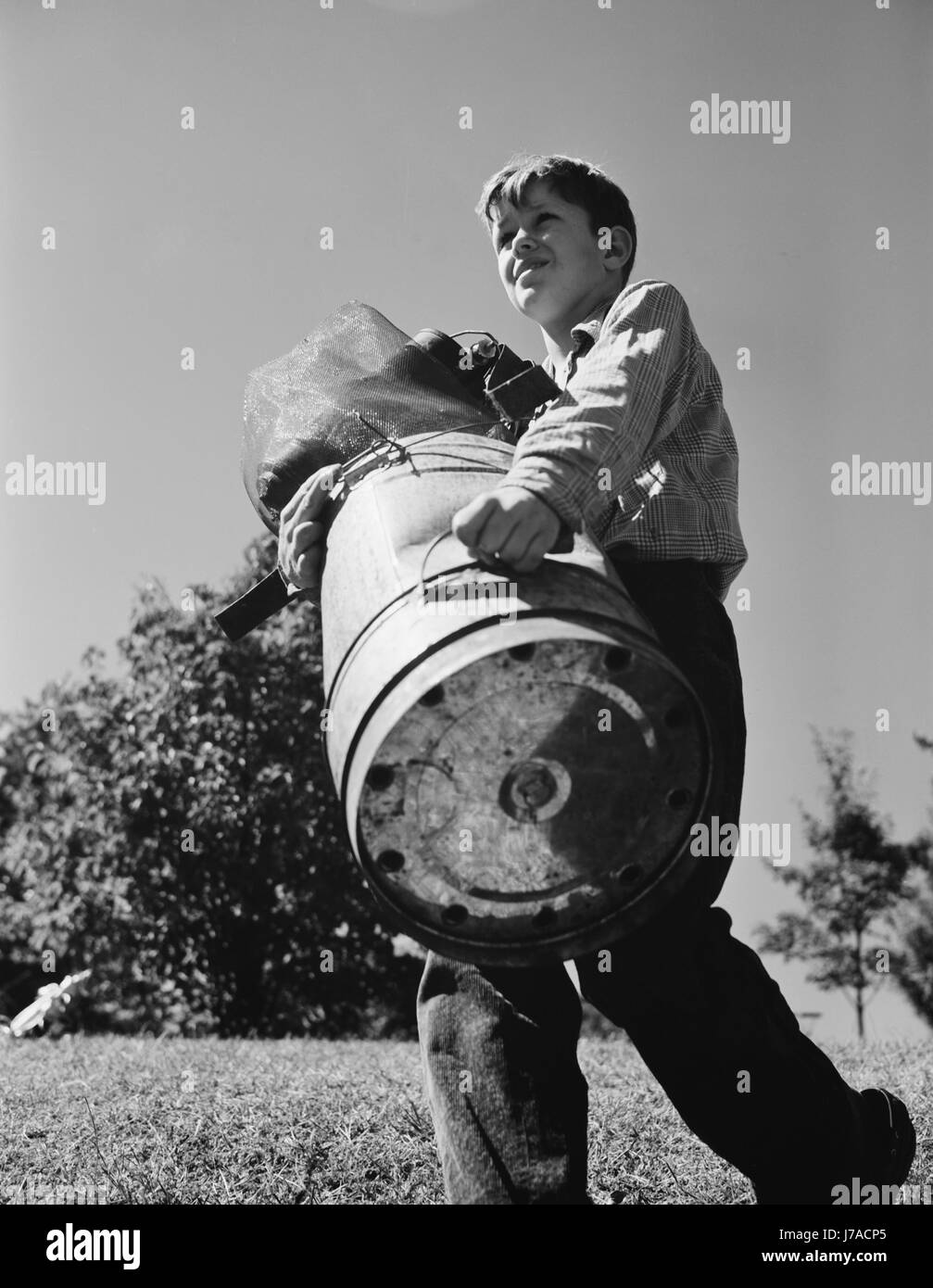 A young boy collects scrap for America's war industries, 1942. - Stock Image