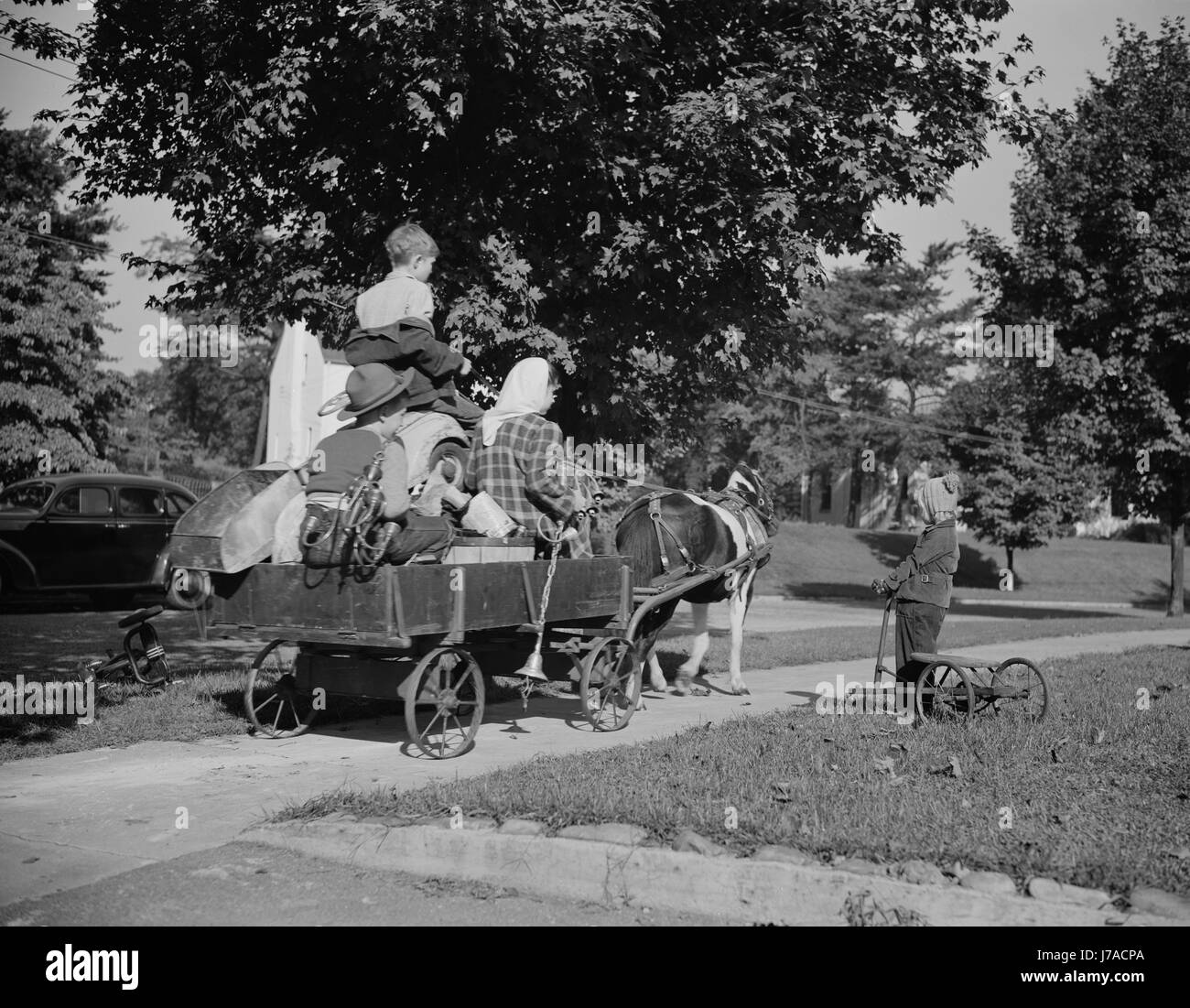 Youngsters collecting scrap on a pony cart for donation to their war industries, 1942. - Stock Image