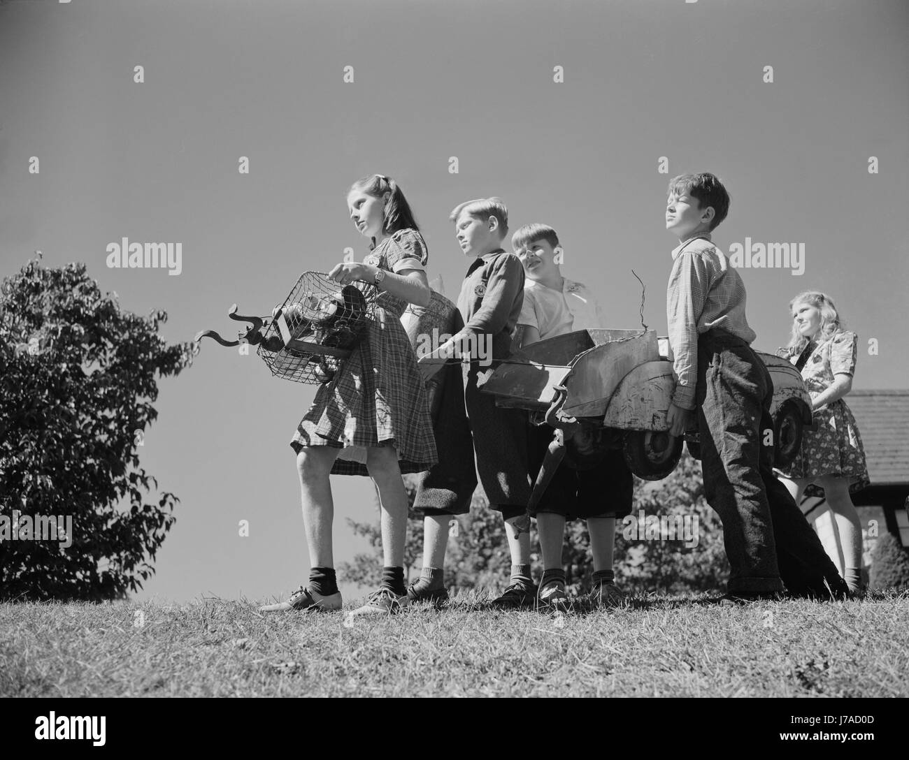Young children collect scrap to donate for our war industries, 1942. Stock Photo