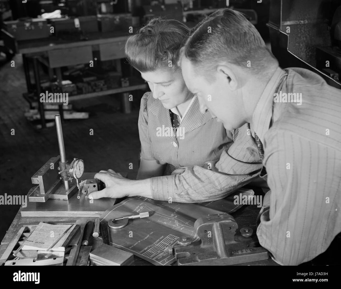 Supervisor checking dimensions of completed V-block, 1942. - Stock Image
