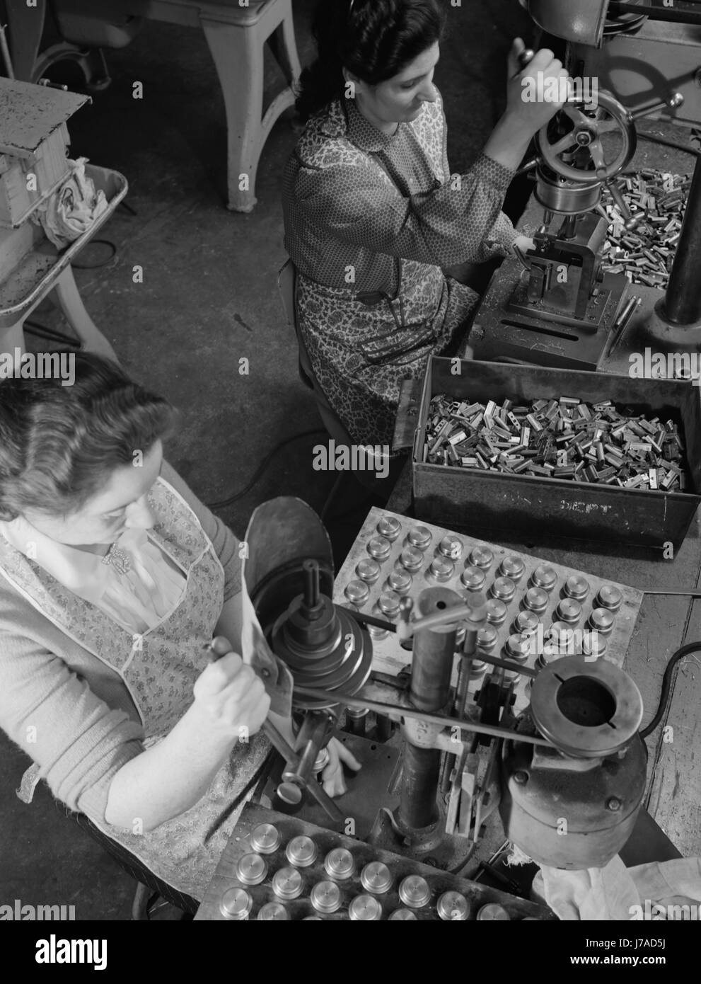 Female workers making parts to be used for war productions efforts, 1942. - Stock Image