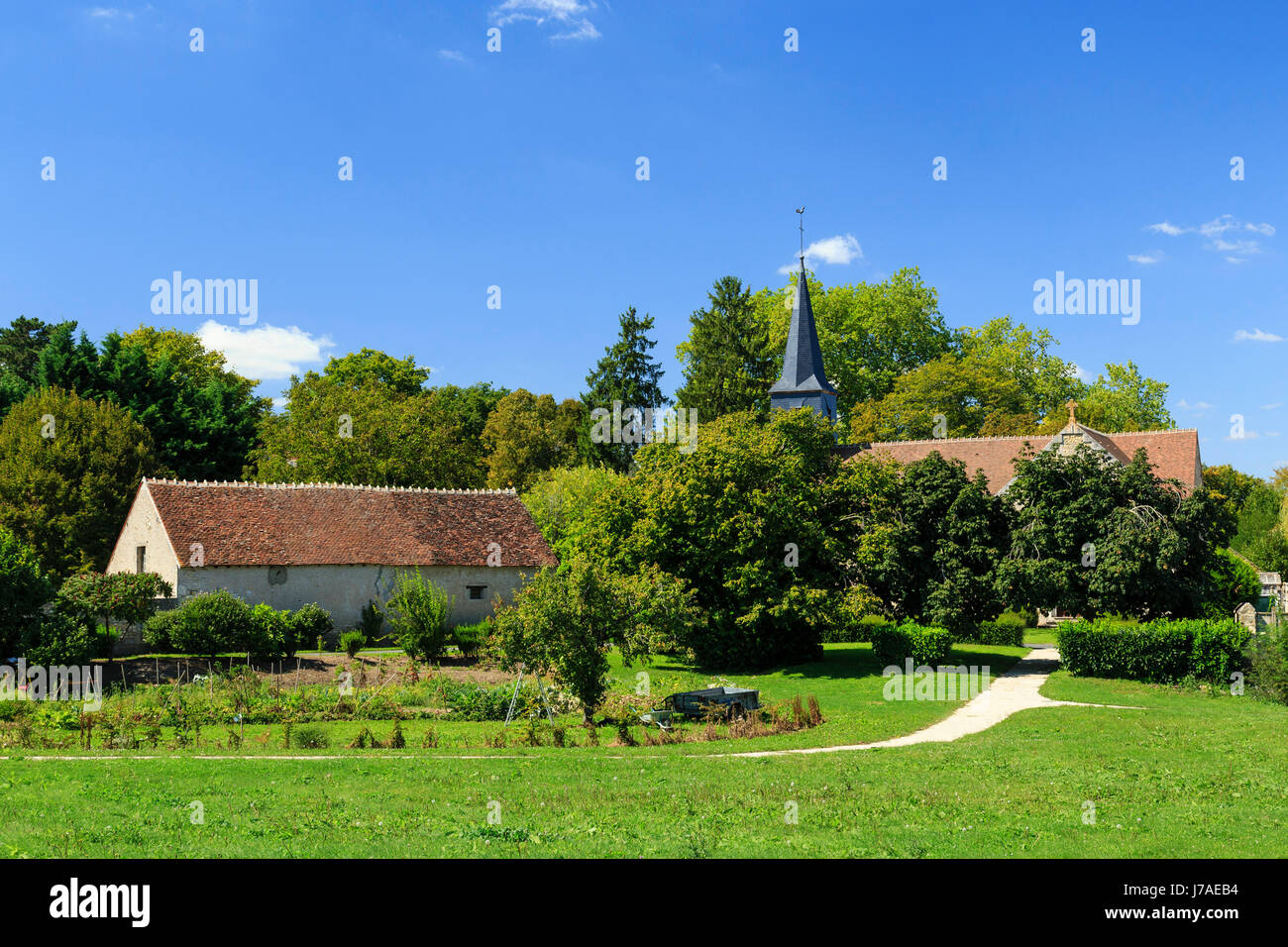 France, Cher, Farges-Allichamps, the center of the village and its church or chapel of the Templars - Stock Image