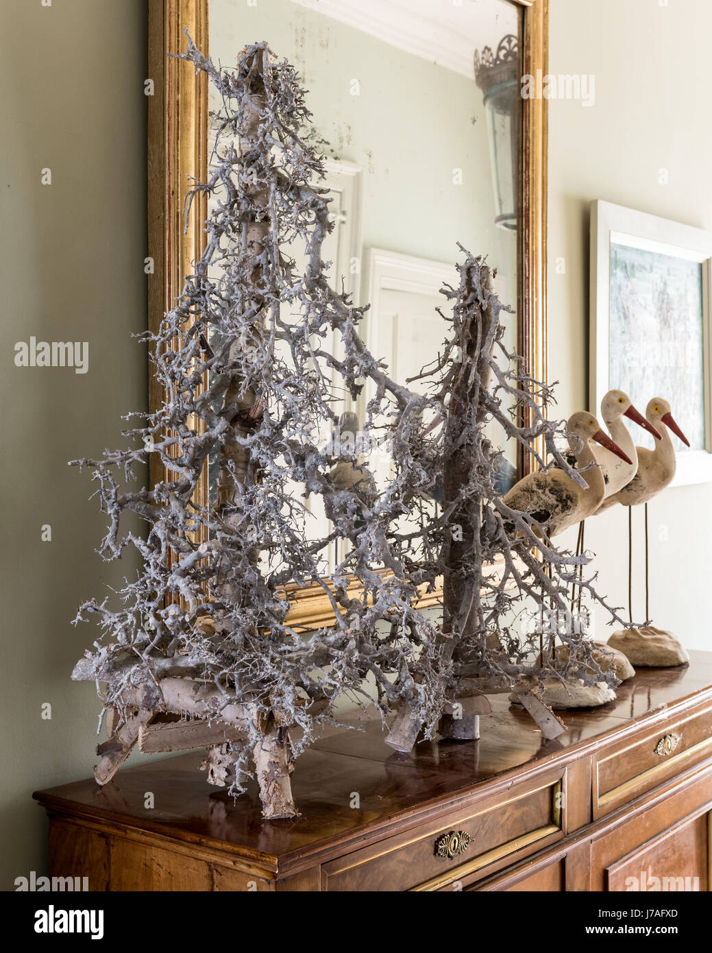 Decorative twig christmas trees on hallway console table - Stock Image