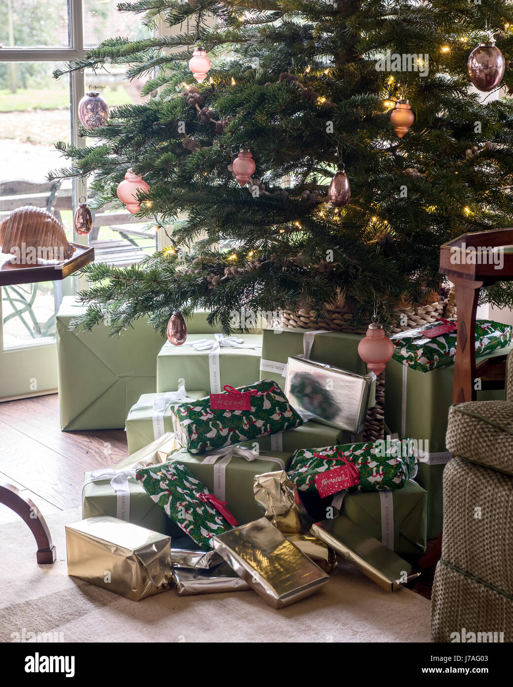 presents under the christmas tree stock image