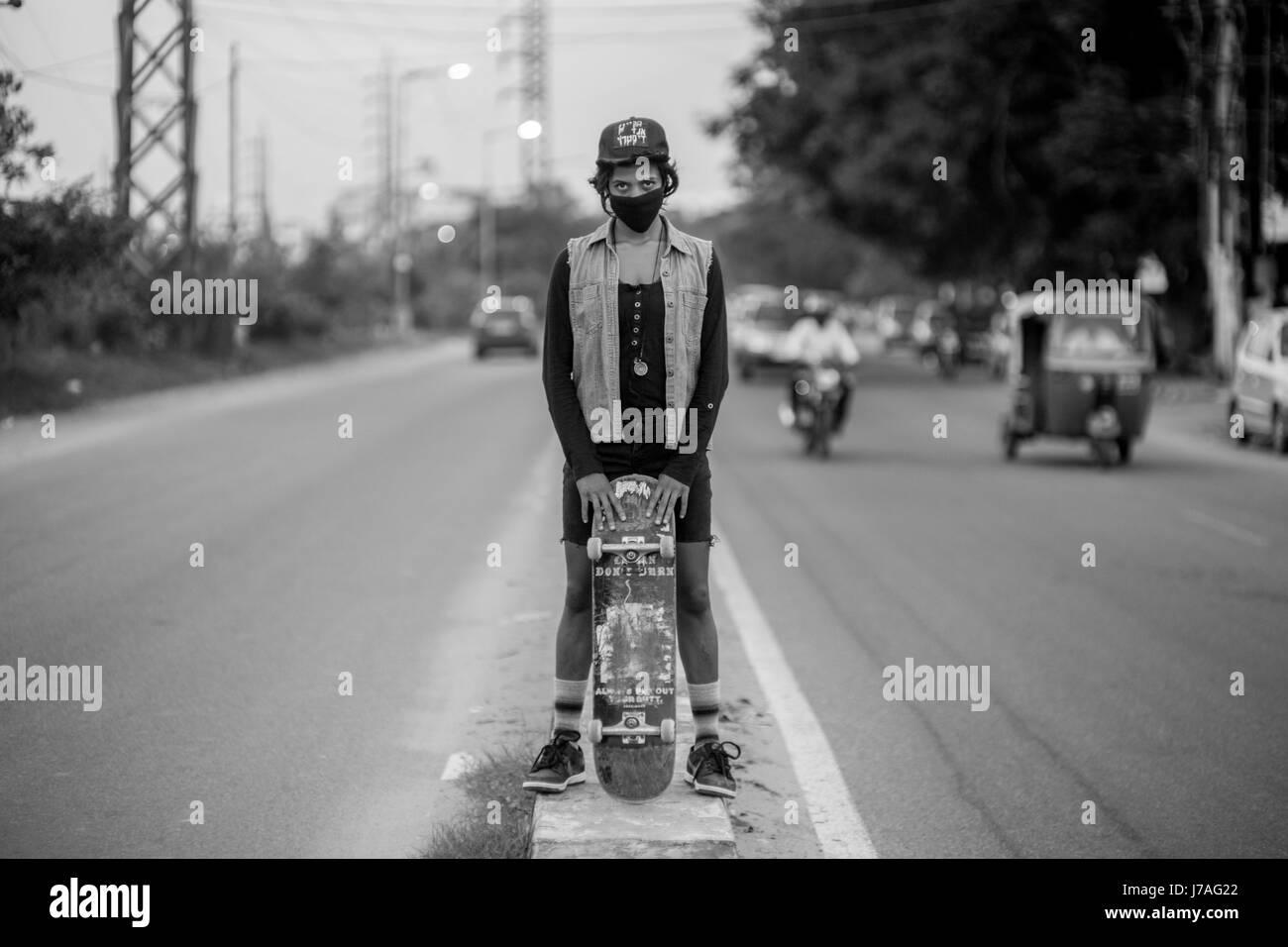 A black and white portrait of Atita Veghese, Indias first professional female skateboarder. - Stock Image