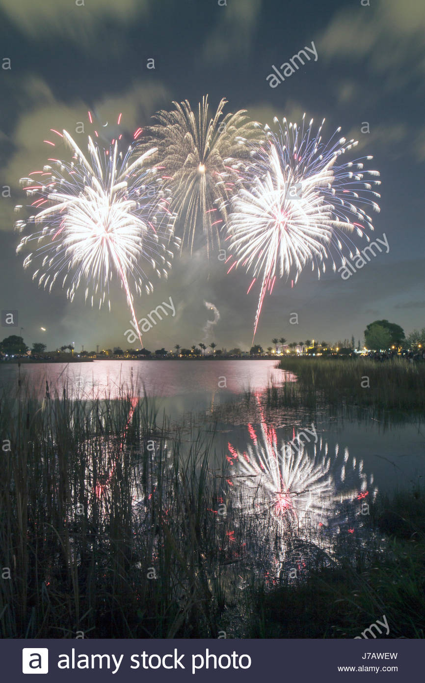 Miami Florida Doral J. C. Bermudez Park Fourth 4th of July celebration tradition fireworks burst water reflection Stock Photo