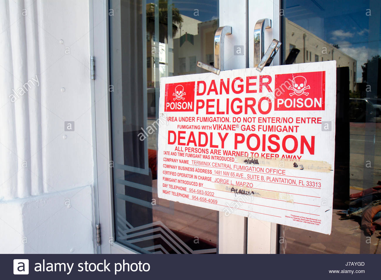 Miami Beach Florida Ocean Drive Savoy Hotel sign deadly poison warning Spanish language bilingual fumigation Vikane - Stock Image