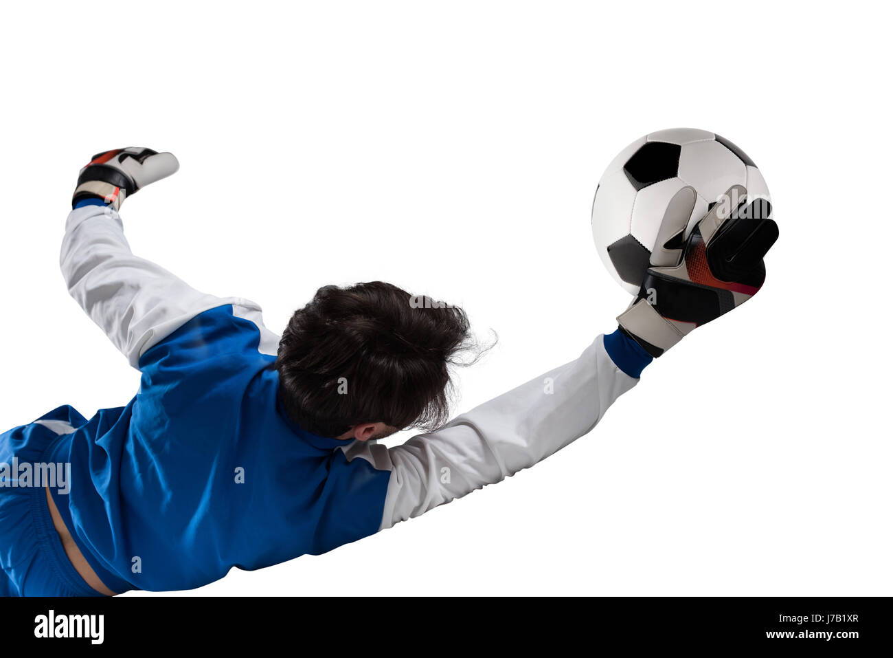 Goalkeeper catches the ball in the stadium - Stock Image