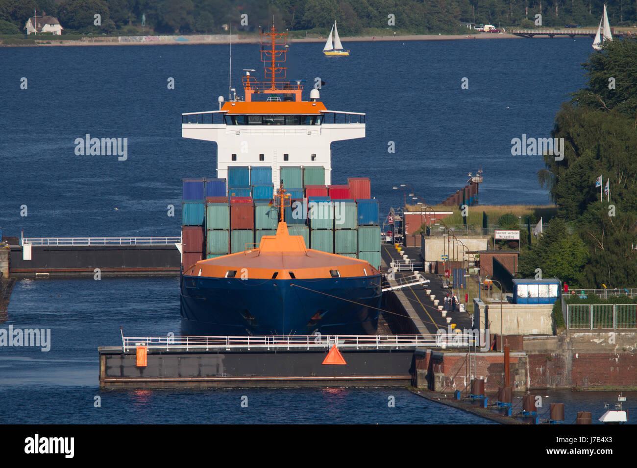 container ship logistics keel sailing boat sailboat rowing boat boat watercraft Stock Photo