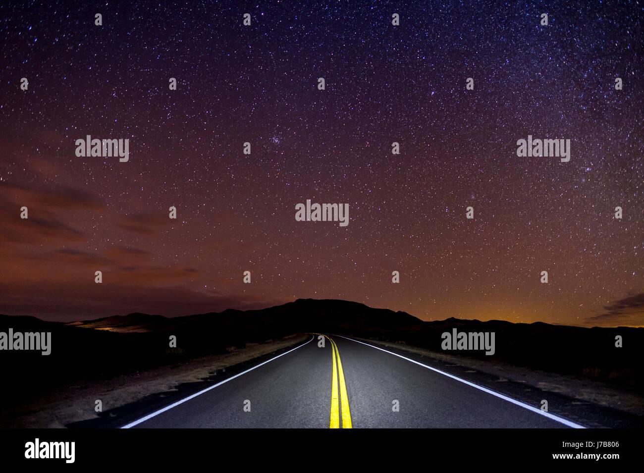 Desert Highway At Night With Stars, Arizona, USA - Stock Image