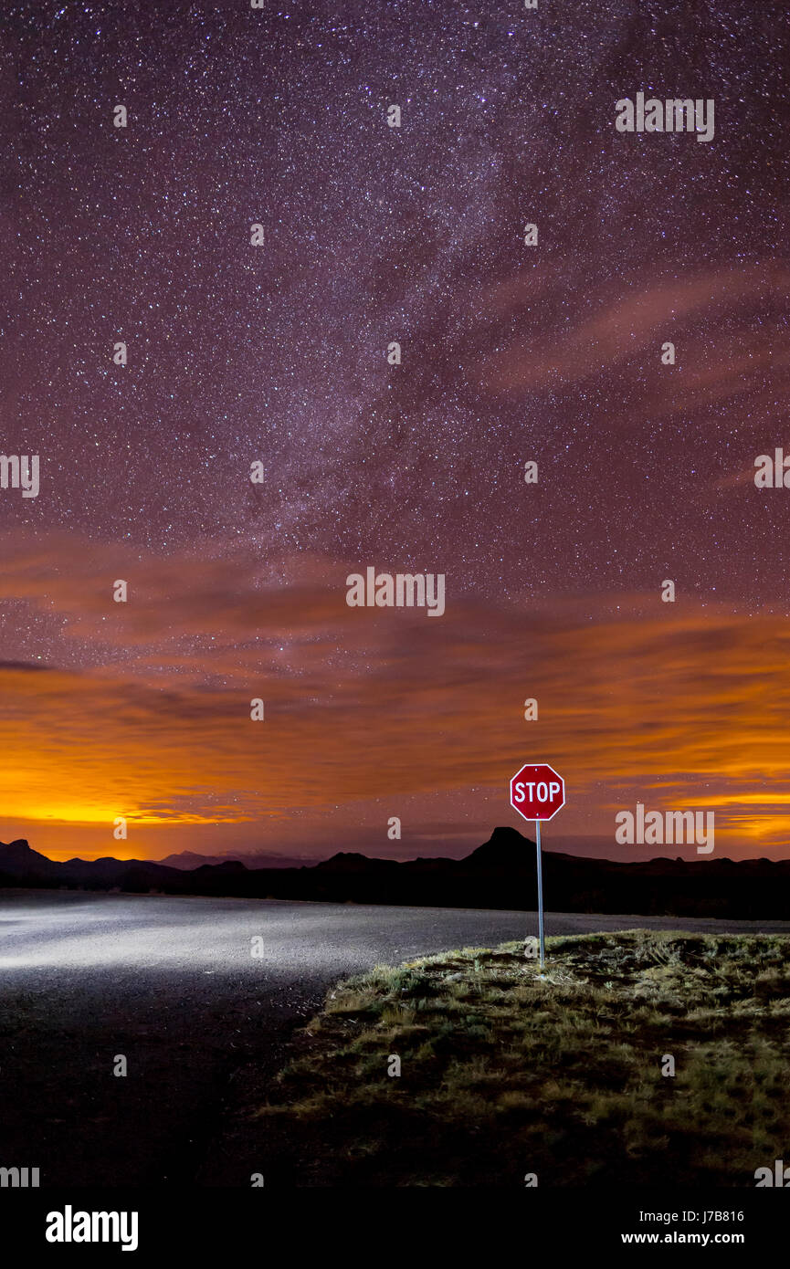 Desert Road Intersection With Stop Sign & Stars - Stock Image
