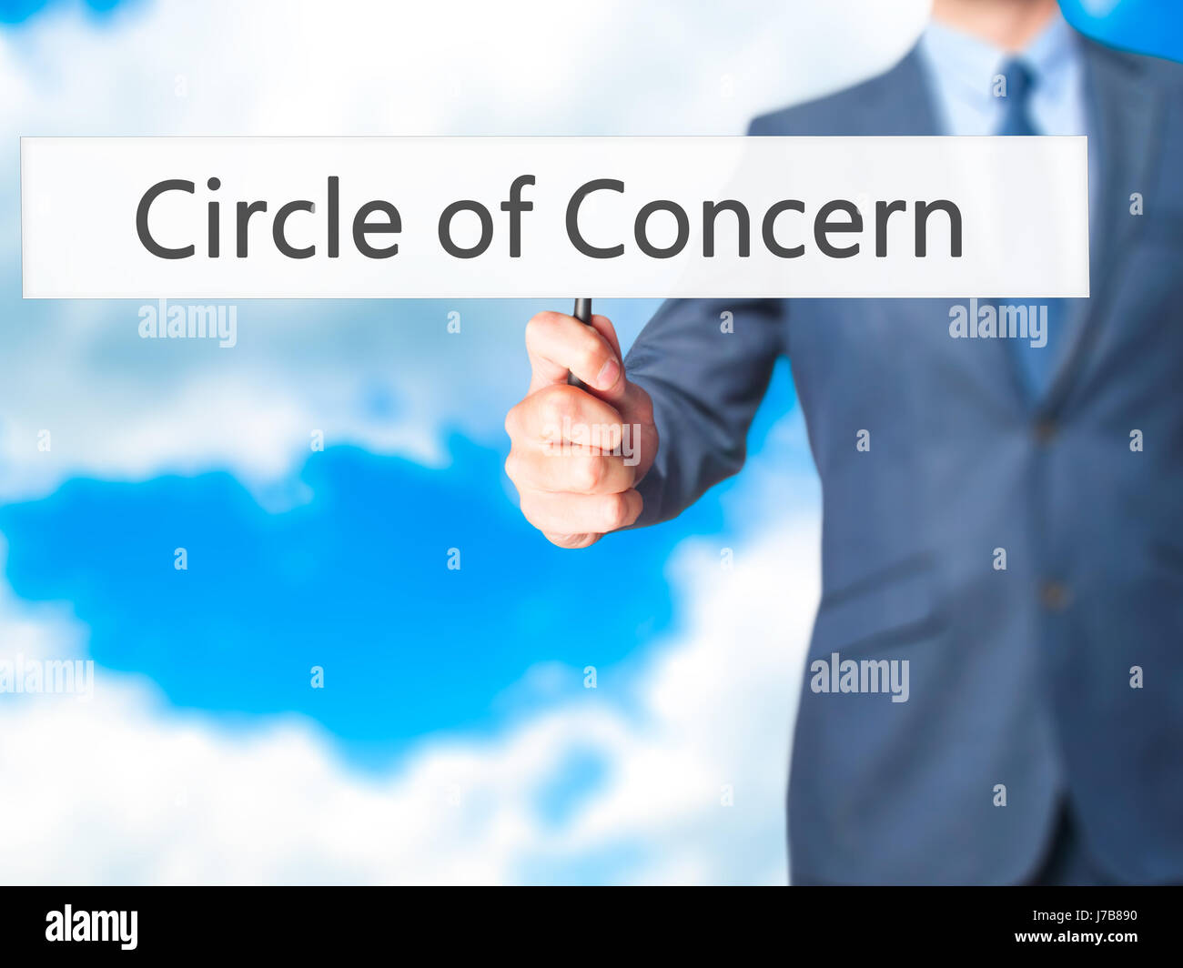 Circle of Concern - Businessman hand holding sign. Business, technology, internet concept. Stock Photo - Stock Image