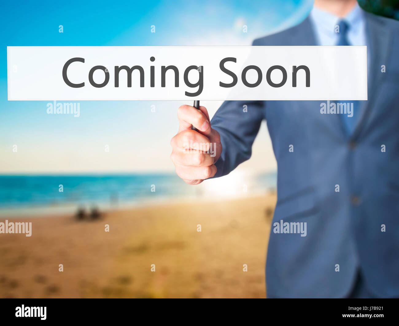 Coming Soon - Business man showing sign  Business
