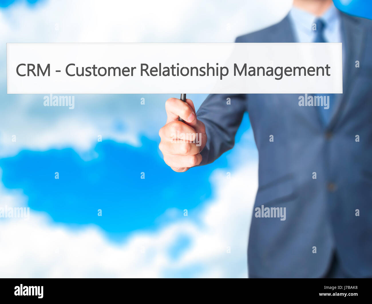 CRM Customer Relationship Management - Business man showing sign. Business, technology, internet concept. Stock - Stock Image