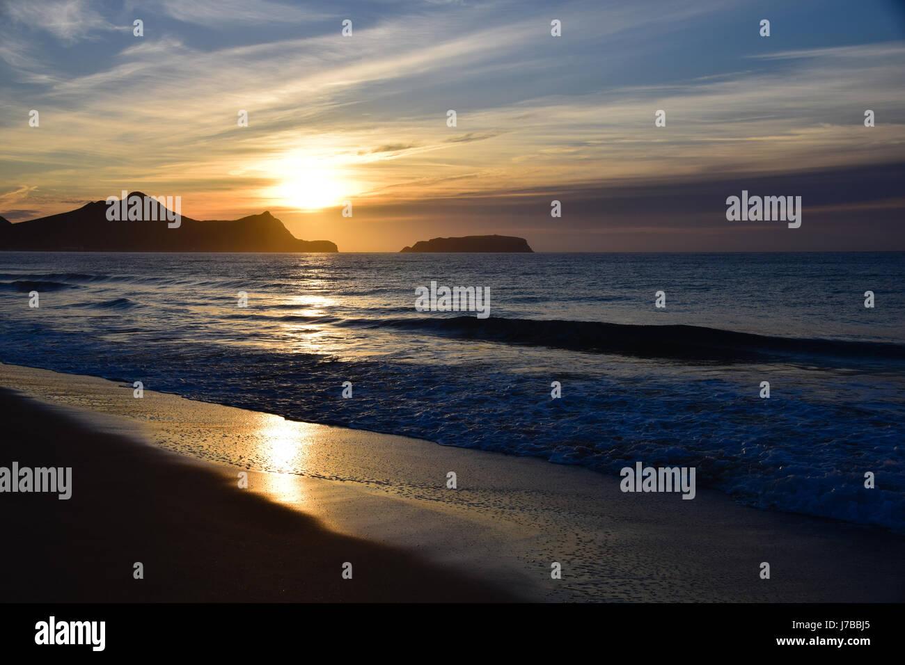 Sunrise over the Atlantic Ocean from Porto Santo beach - Stock Image