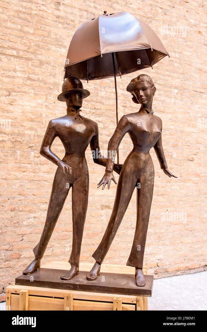 Bronze Sculpture of a couple with Umbrella Bologna Italy - Stock Image