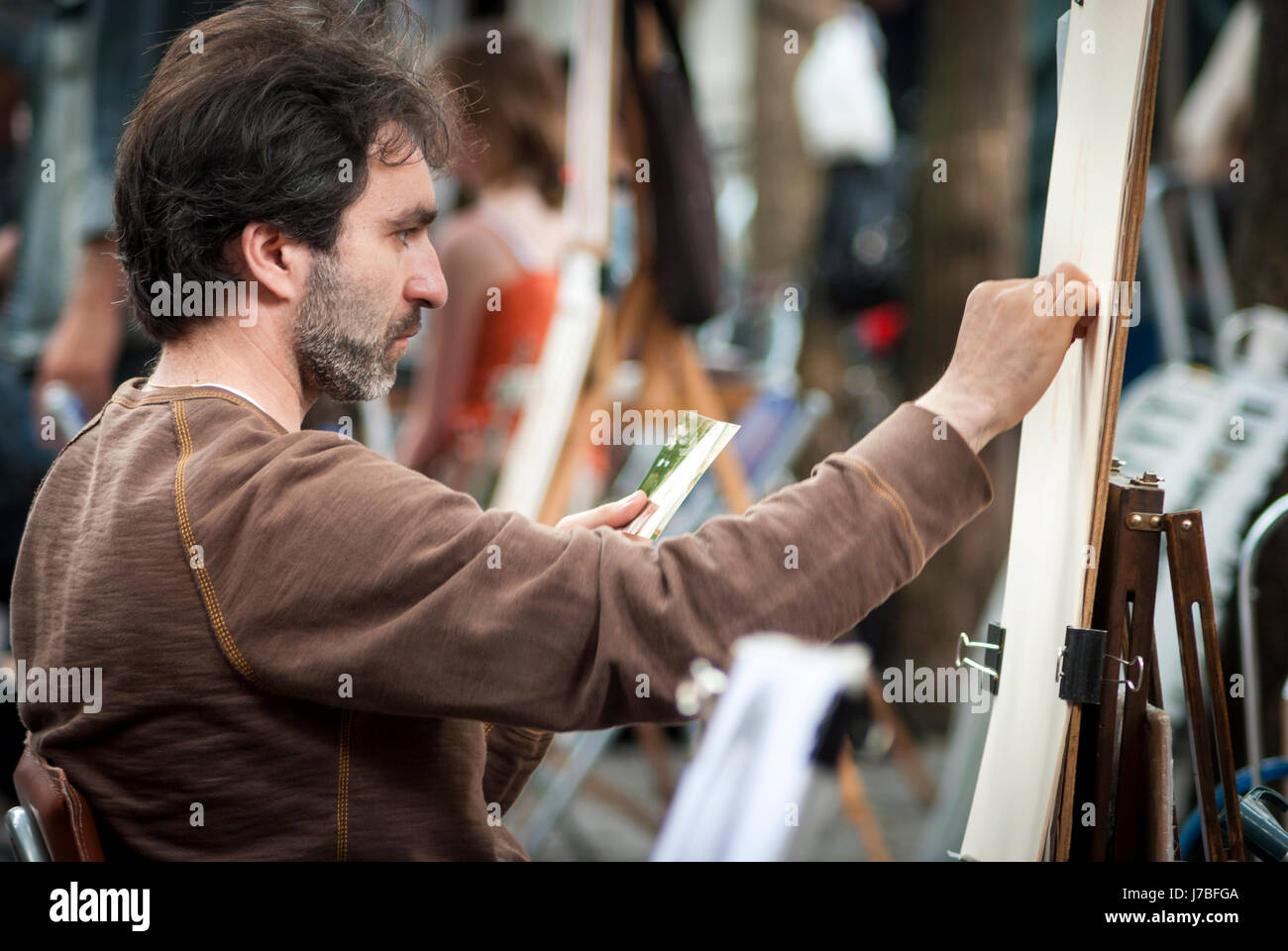 Portrait of a sreet artist on Montmartre in Paris - Stock Image