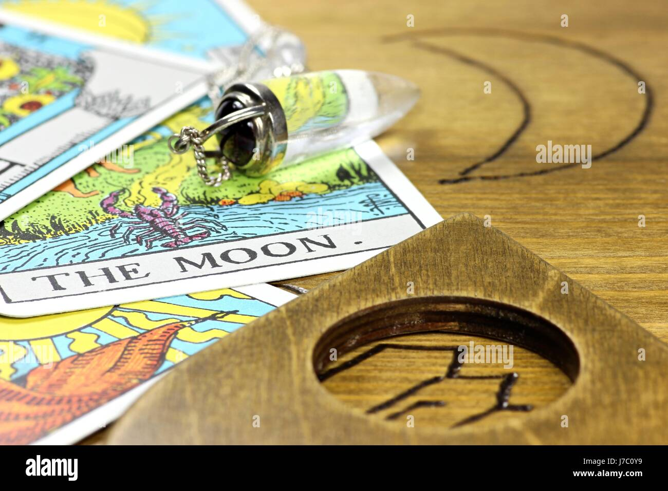 the moon shown by fortune telling accessories - Stock Image