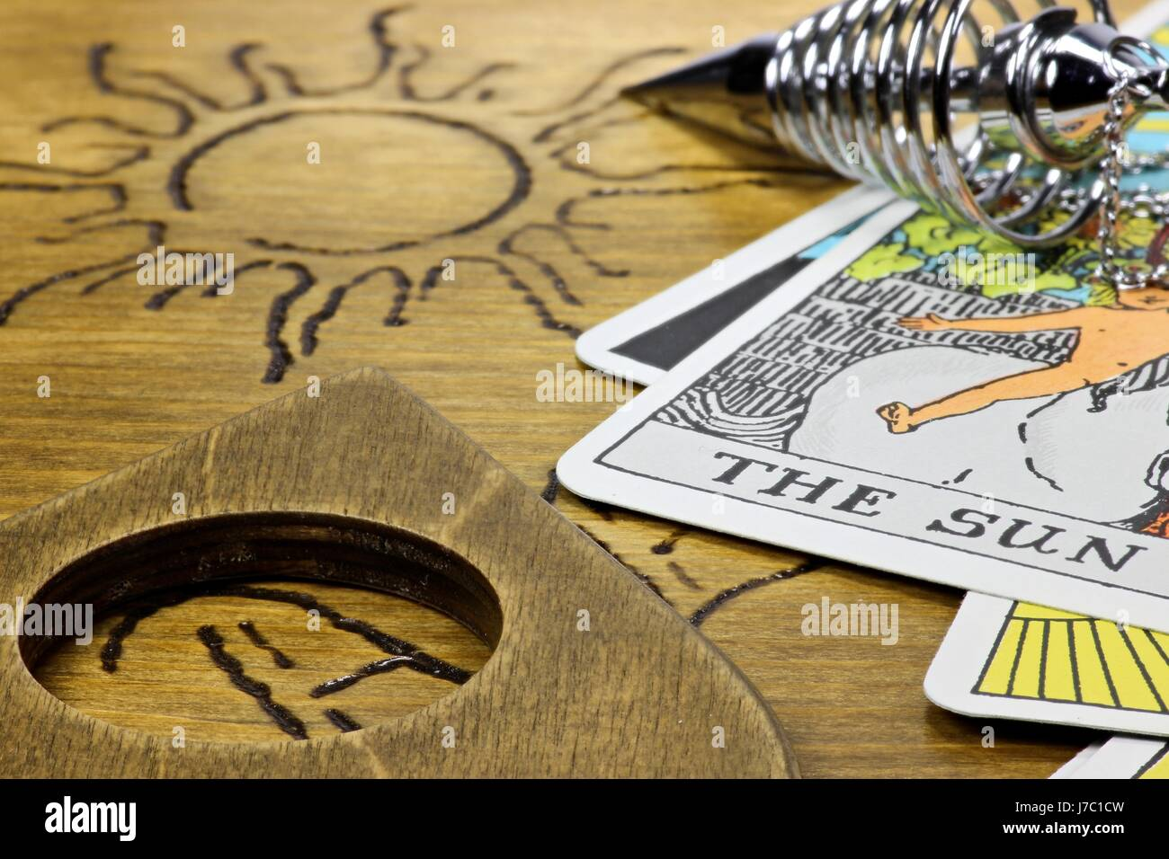 the sun shown by fortune telling accessories - Stock Image