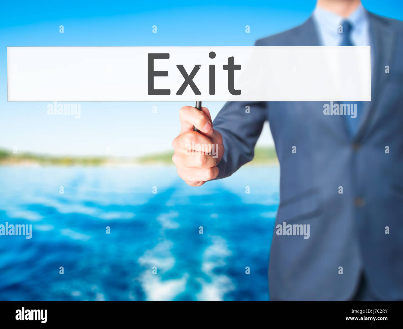 Exit - Businessman hand holding sign. Business, technology, internet concept. Stock Photo - Stock Image