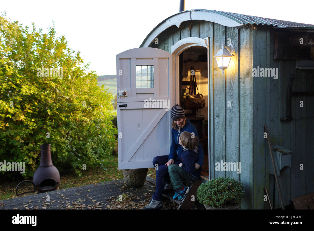Mother and son at a glamping hut, Scottish borders, UK. - Stock Image