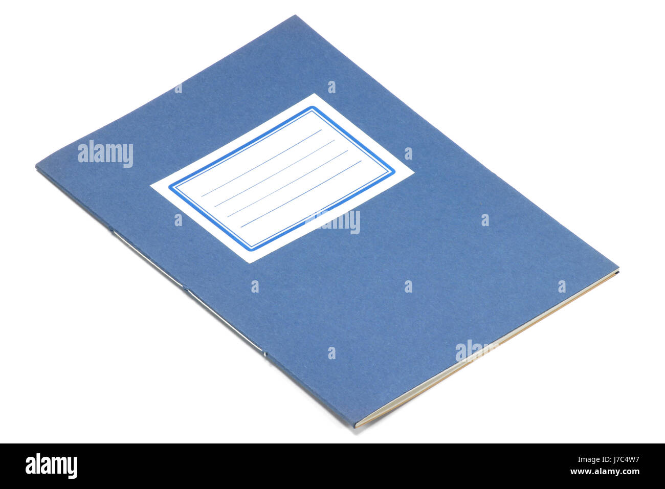 old exercise book isolated on white background - Stock Image