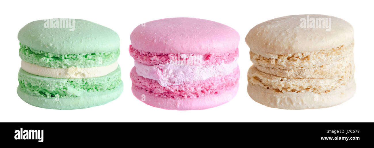 Multi colored sweet macaroons, green, pink, coffee, french traditional, macro, isolated on a white background - Stock Image