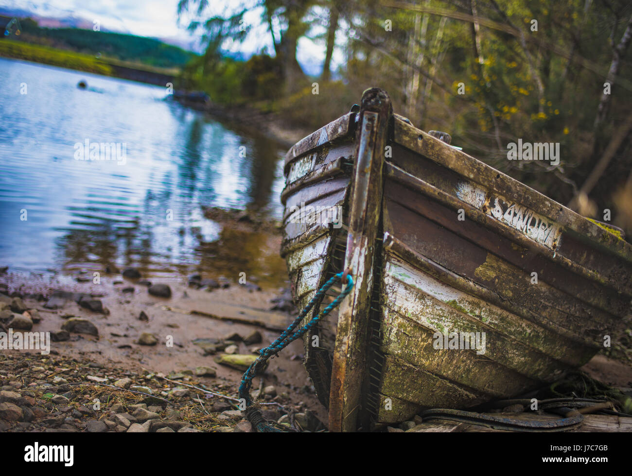 Old wooden dingy at Gairlocky bay - Stock Image