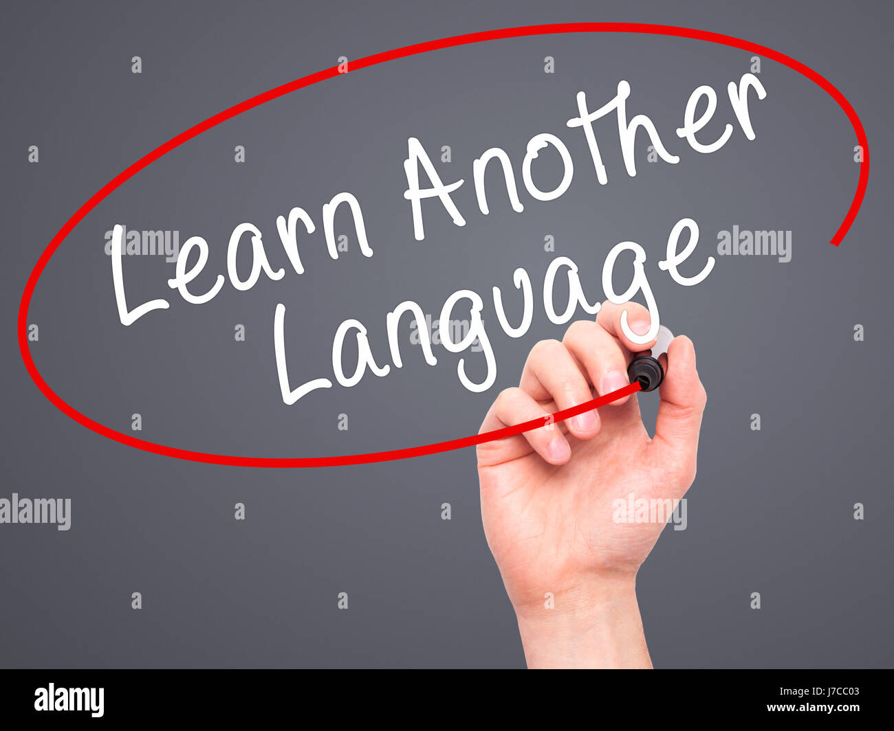 Man Hand writing Learn Another Language with black marker on visual screen. Isolated on grey. Learn, technology, - Stock Image