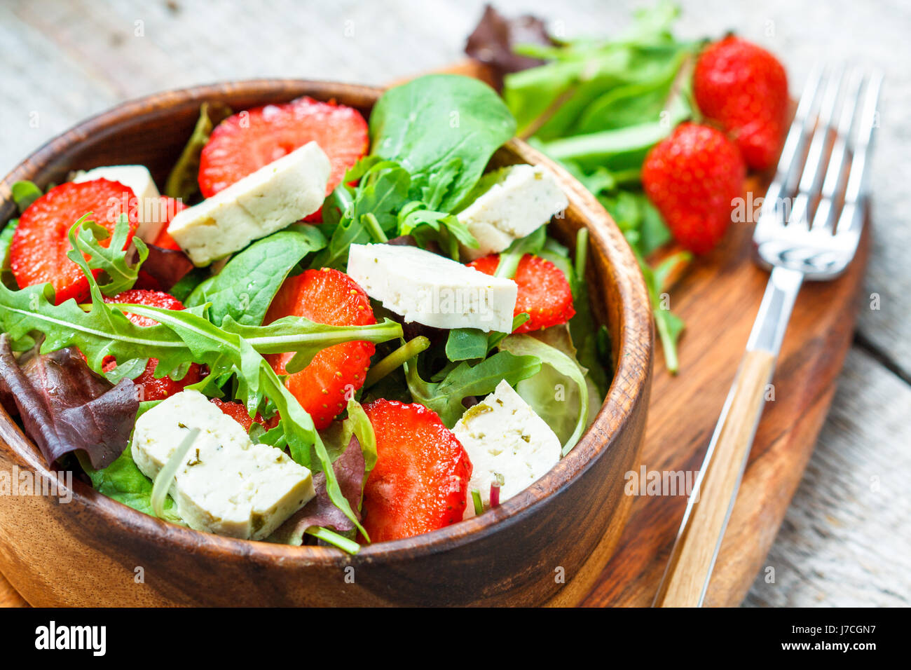 Vegan salad with tofu and strawberries. Love for a healthy vegan food concept Stock Photo