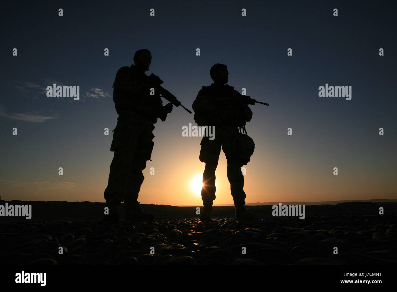 silhouette of a Royal Marine Commandos near Kala Bost Fort 2km south of Lashkah Gar, Helmand Province, Afghanistan - Stock Image