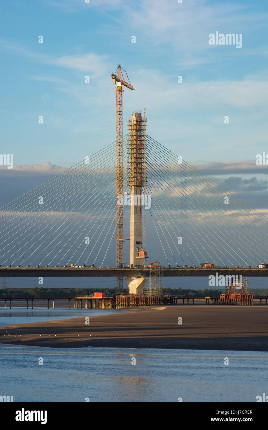 The North Pylon of the Mersey Gateway Construction Project River Mersey Crossing in evening light. - Stock Image