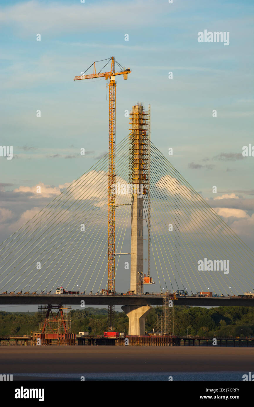 The South Pylon of the Mersey Gateway Construction Project River Mersey Crossing in evening light. - Stock Image