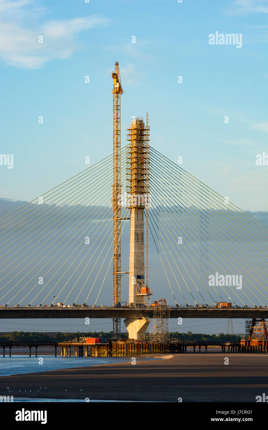 The Central Pylon of the Mersey Gateway Construction Project River Mersey Crossing in evening light. - Stock Image