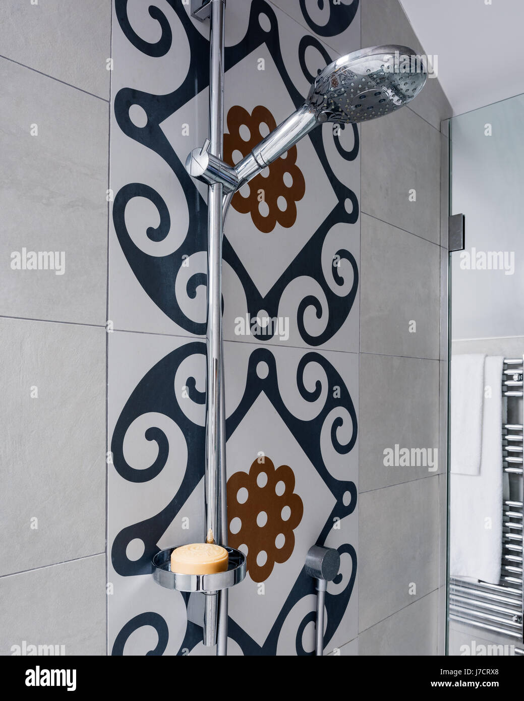 Shower fitting with dramatic Majolica tiles - Stock Image