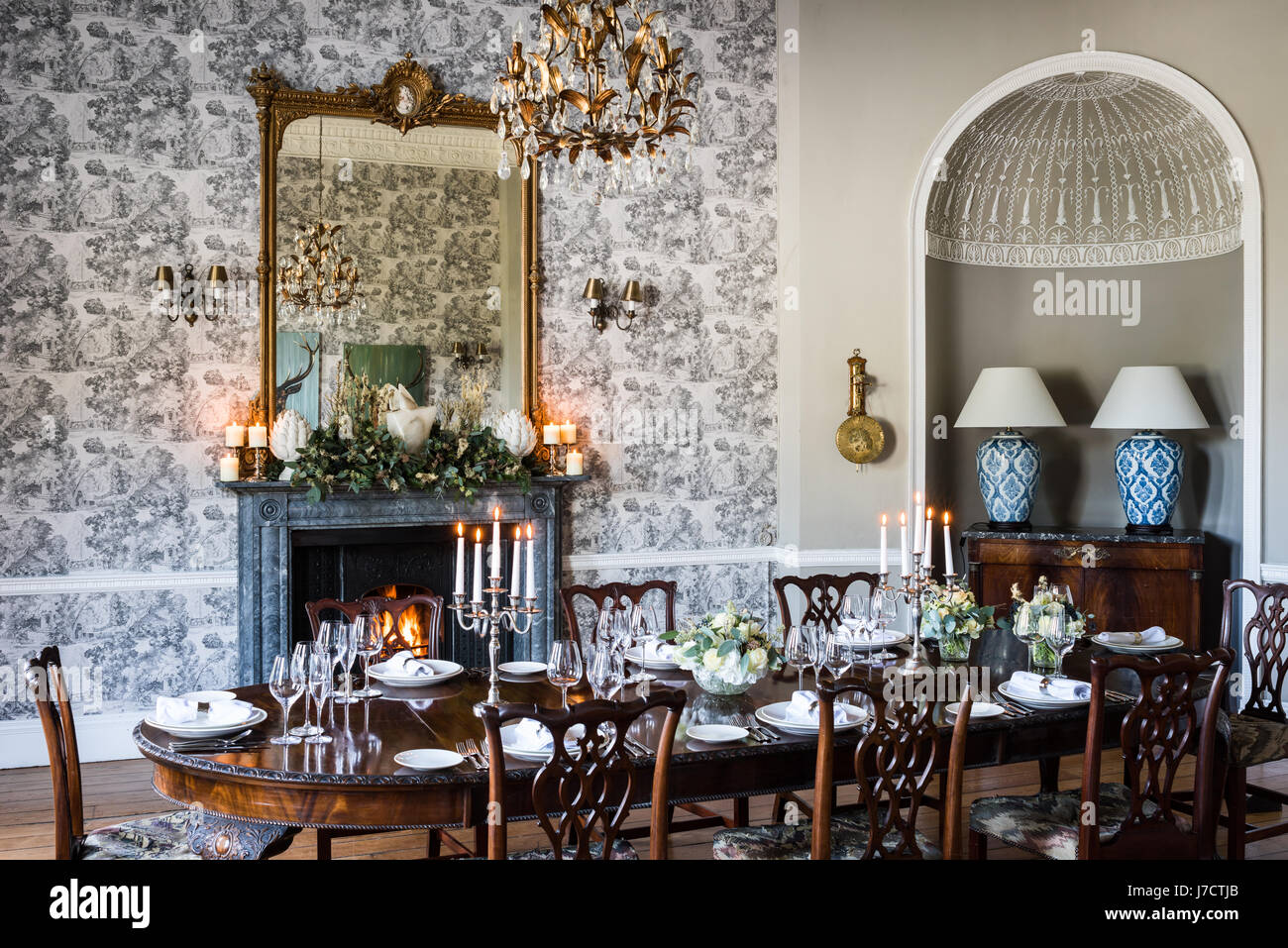 Dining Room With Glass And Gilt Chandelier From Jfm Interiors Above Table Laid For A Formal Meal Large Mirror Is The Mantelpiece