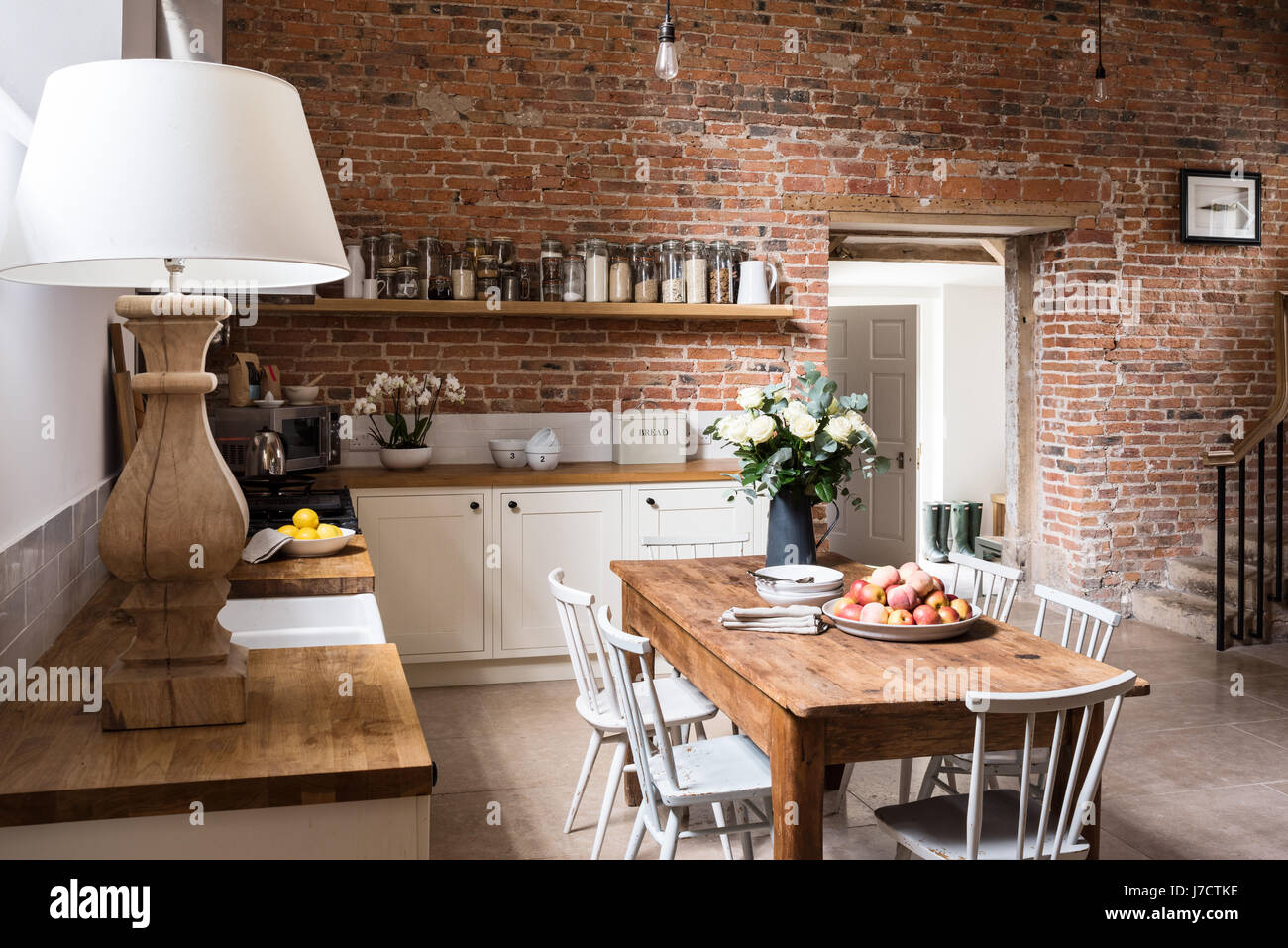 Exposed brick wall in contemporary feeling kitchen with ...