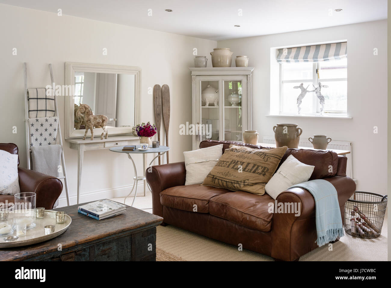 Laura Ashley Leather Sofa And Grey Armoire From Scandi Living In Sitting Room With Indian Dowry Chest Decorative Oars The Walls Are Painted Po